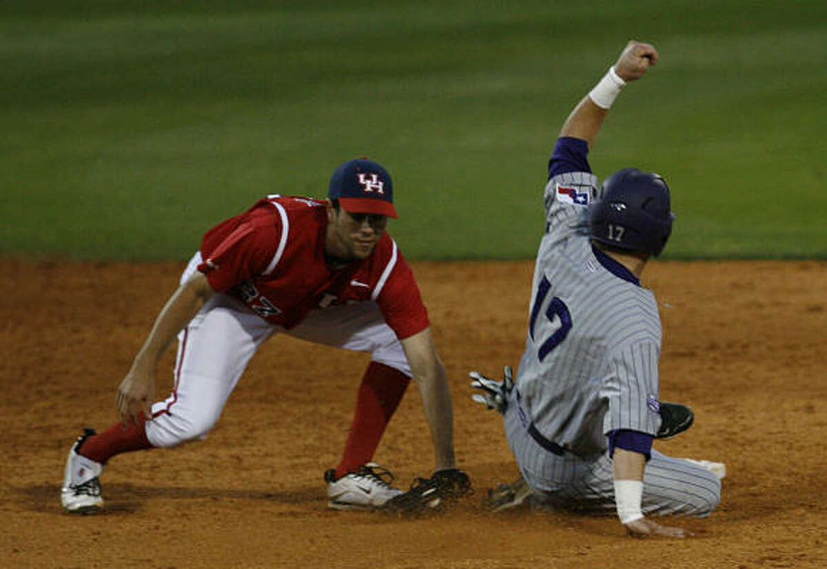 UH infielder Travis Trial, left, tags out TCU's Matt Curry.