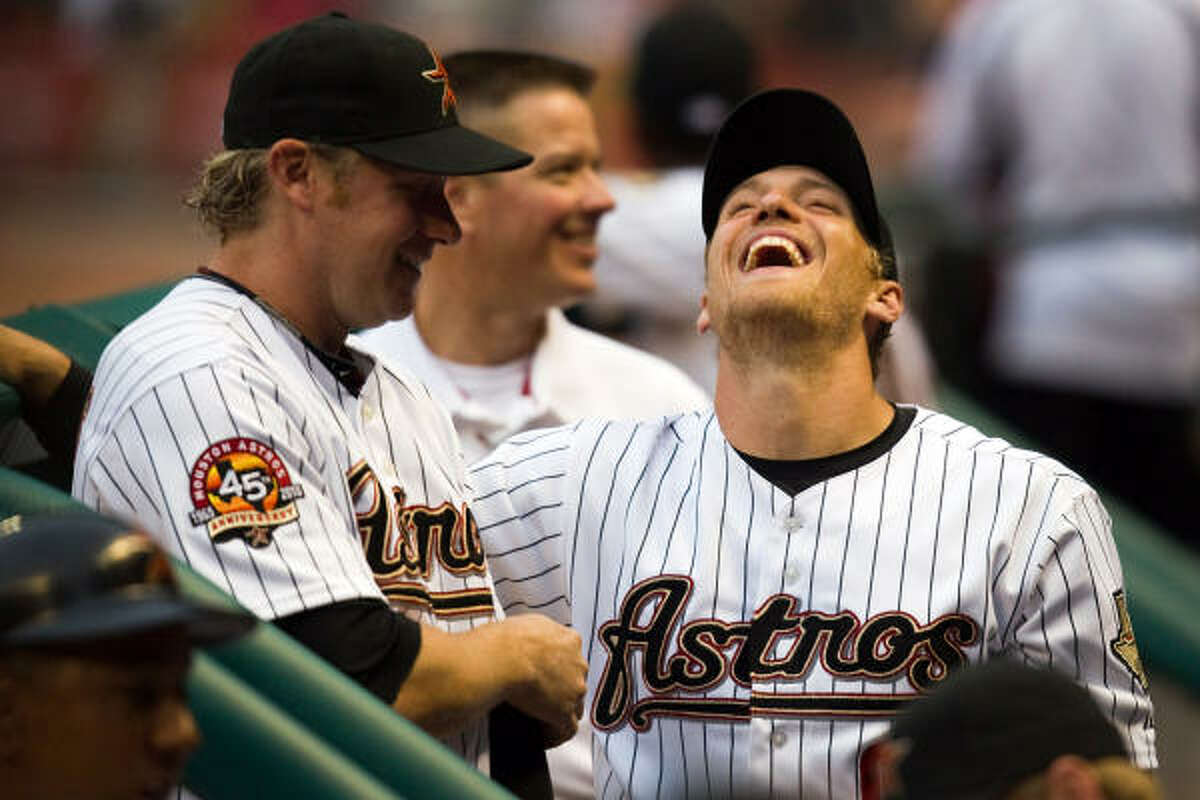 Astros right fielder Hunter Pence laughs with teammate Jason Michaels before the start of the game.