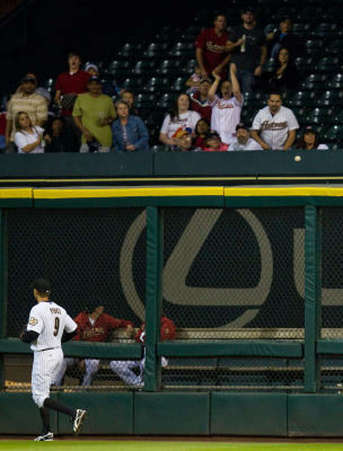 Astros right fielder Hunter Pence watches as a home run off the bat of Philadelphia Phillies second baseman Chase Utley lands in the Astros bullpen during the fourth inning. Photo: Smiley N. Pool, Chronicle