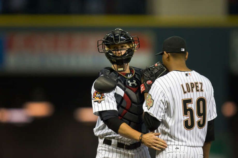 Astros catcher J.R. Towles visits relief pitcher Wilton Lopez after a home run by Phillies second baseman Chase Utley during the fourth inning. Photo: Smiley N. Pool, Chronicle