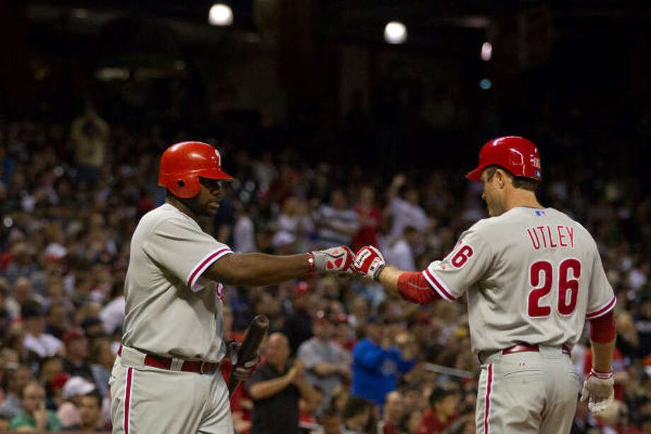 Phillies Ryan Howard congratulates second baseman Chase Utley after his homer. Photo: Smiley N. Pool, Chronicle