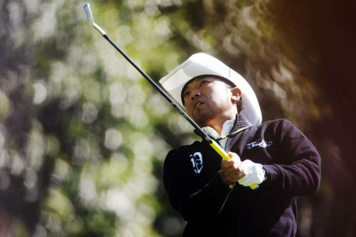 Shingo Katayama hits his tee shot on the fourth hole.