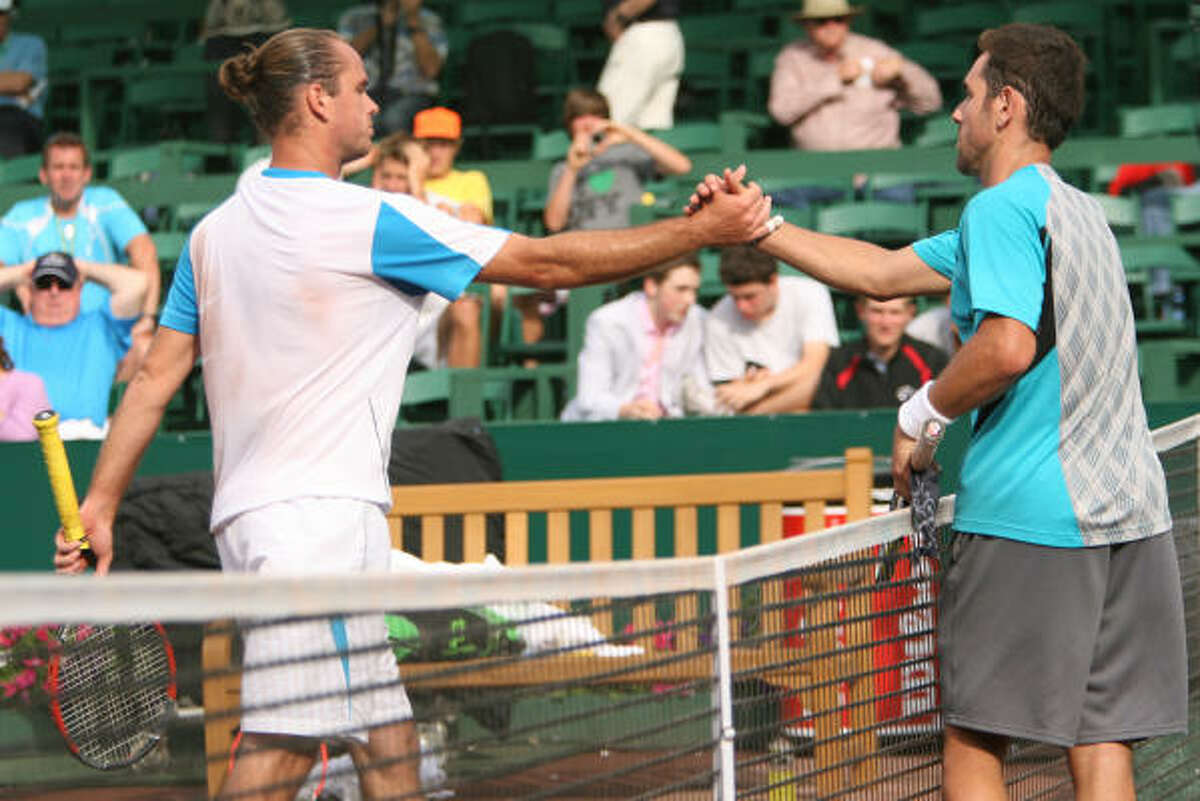 U.S. Men's Clay Court Championship: Day 5 Wayne Odesnik, right, is congratulated by Xavier Malisse after winning their semifinal matchup Friday in Baytown.