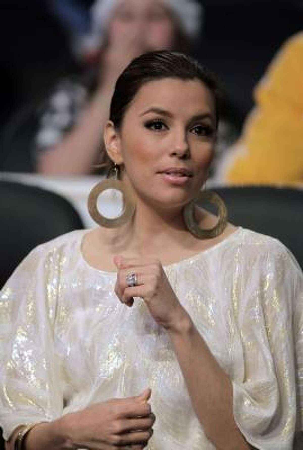 Actress Eva Longoria watches an NBA basketball game between Los Angeles Lakers and the San Antonio Spurs in Los Angeles.