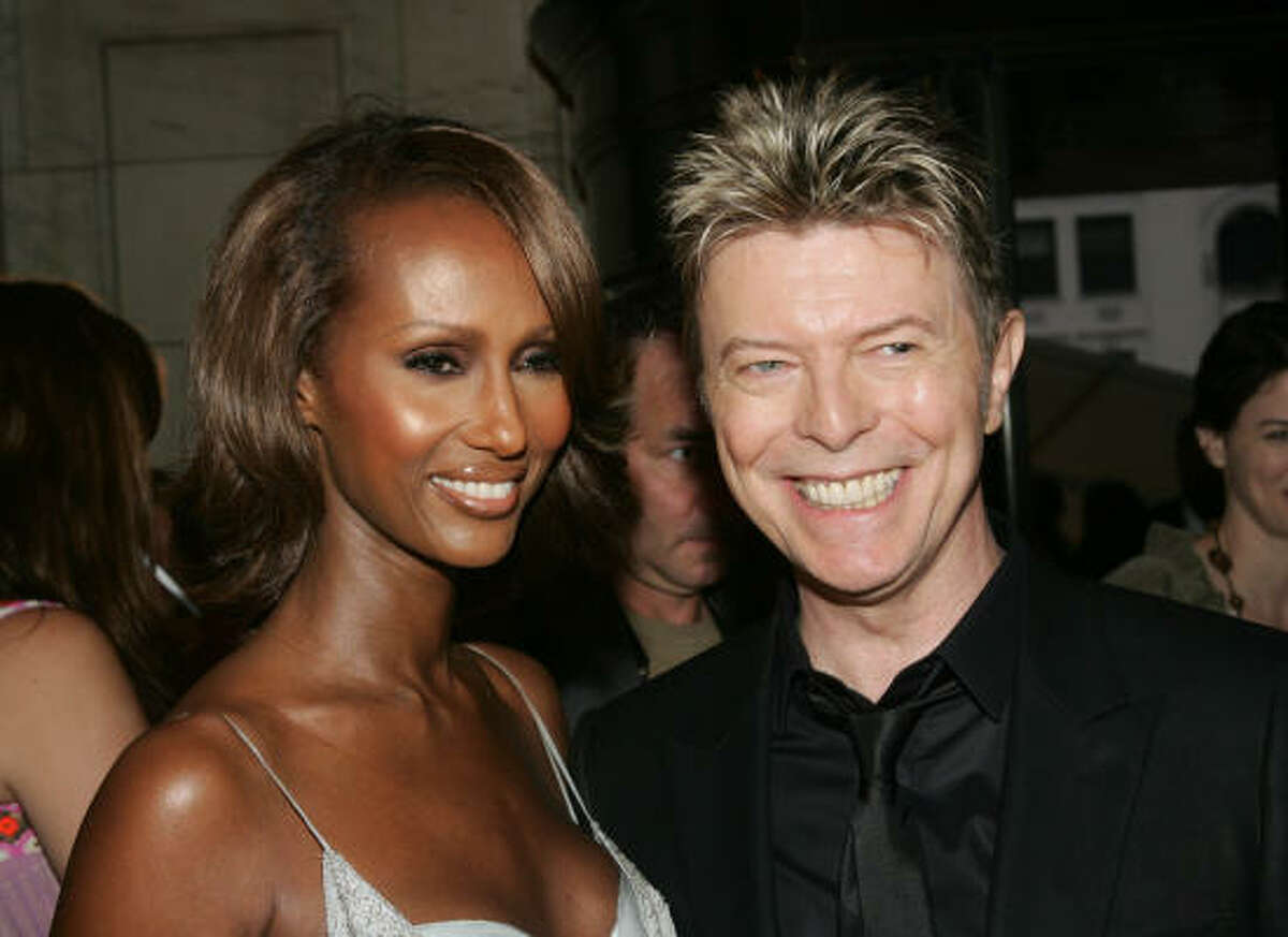 Iman (Muslim) and David Bowie (agnostic) When Bowie married the Somalian model in 1992, they got tattoos symbolizing their union.