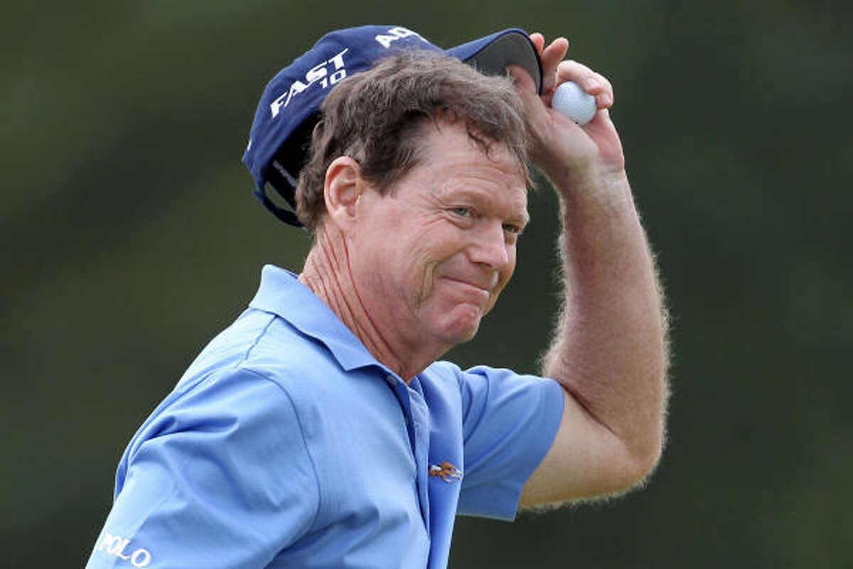 Tom Watson waves to the gallery on the 18th green after finishing the first round at five-under par 67.