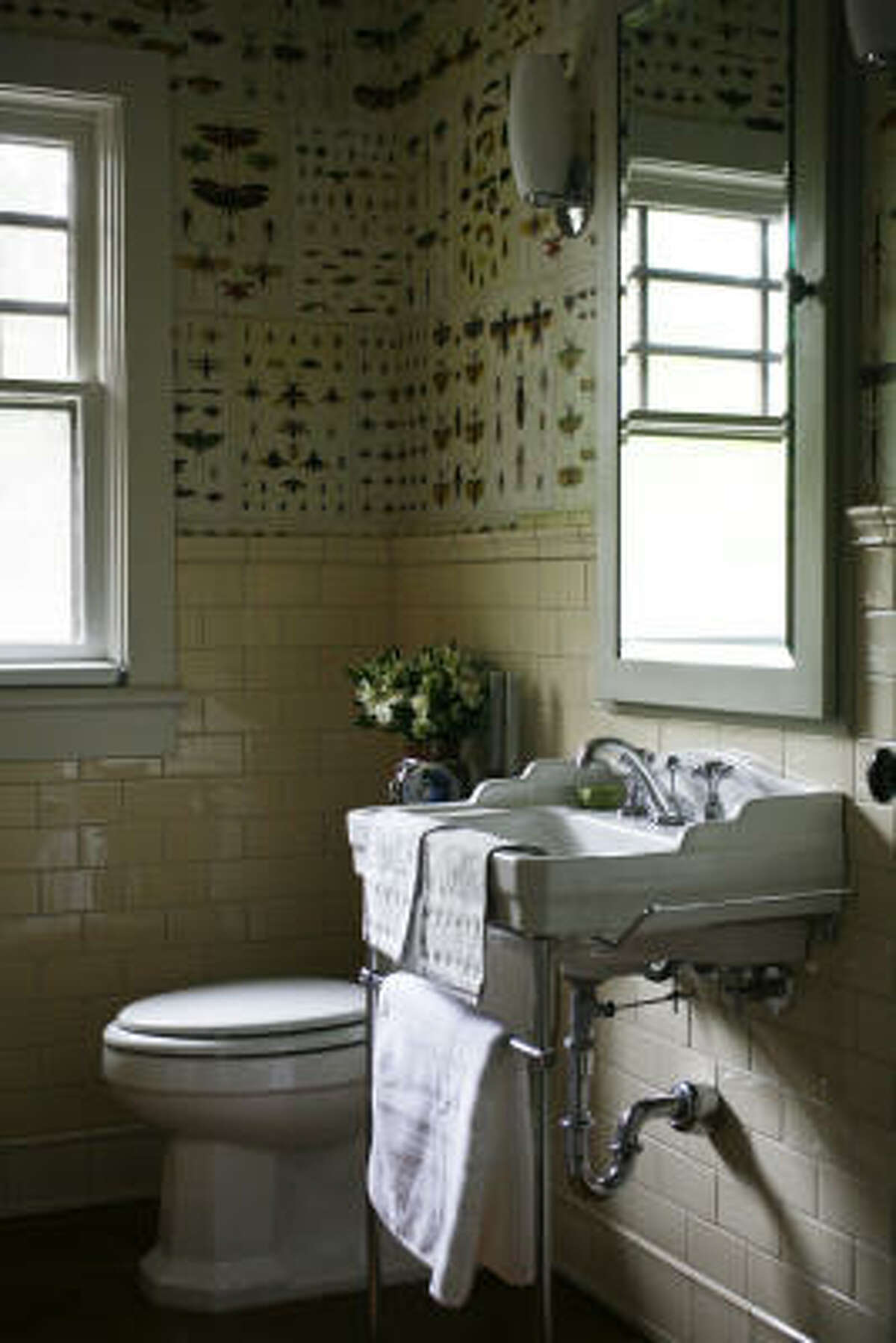 The bathroom is one of a kind, with walls papered in pages from Cabinet of Natural Curiosities by Albertus Seba.