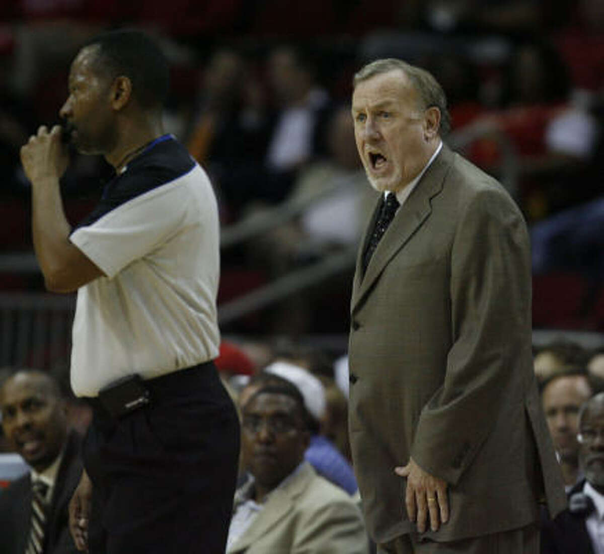 Rockets head coach Rick Adelman yells to a referee during the first half. Adelman received his 900th coaching win with the Rockets 113-96 victory over the Jazz.