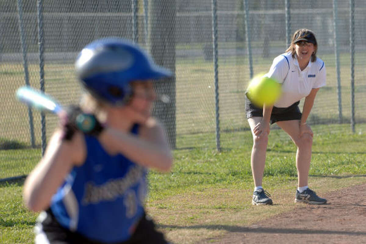 EPISCOPAL vs WESTBURY CHRISTIAN: Episcopal softball head coach Amy Gready watches from third base as Abigail Roberts lets a high pitch go by during the Episcopal vs. Westbury softball game on March 29.