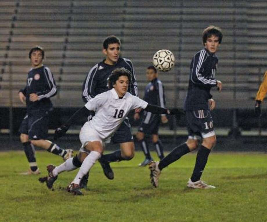 WESTSIDE 1, LAMAR 0:Westside's Brandon Baez (#18) controls the ball among a throng of Lamar players during their game at Dyer. Lamar's Scott Ramsey (#17) is at left, Jorge Gabitto is directly behind Brandon Baez and at right is Luke Reed (#10). Photo: Tony Bullard