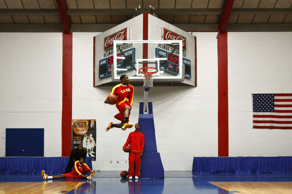 Brandon Peters (23) goes up for a dunk during warmups before the Yates vs. Sterling basketball game in the Regional Bi-District 4A Playoff game at Delmar Stadium in Houston. Yates went on to win the game 126-61, winning their 52nd consecutive game and marking the team's 10th consecutive 100-point game, tying Cayuga for the state record.