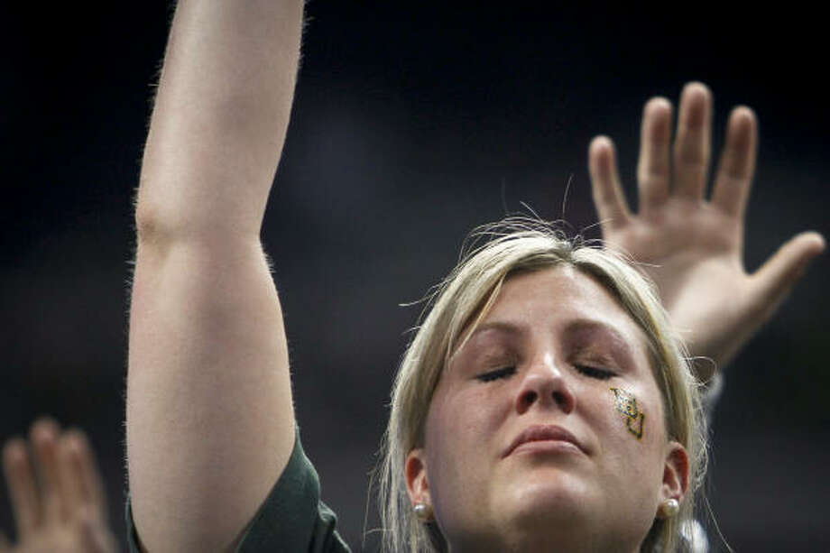 A fan reacts at the end of the game after Baylor lost to Duke 78-71 during the 2010 NCAA Men's Basketball South Regional Championship men's college basketball game. Photo: Michael Paulsen, Chronicle