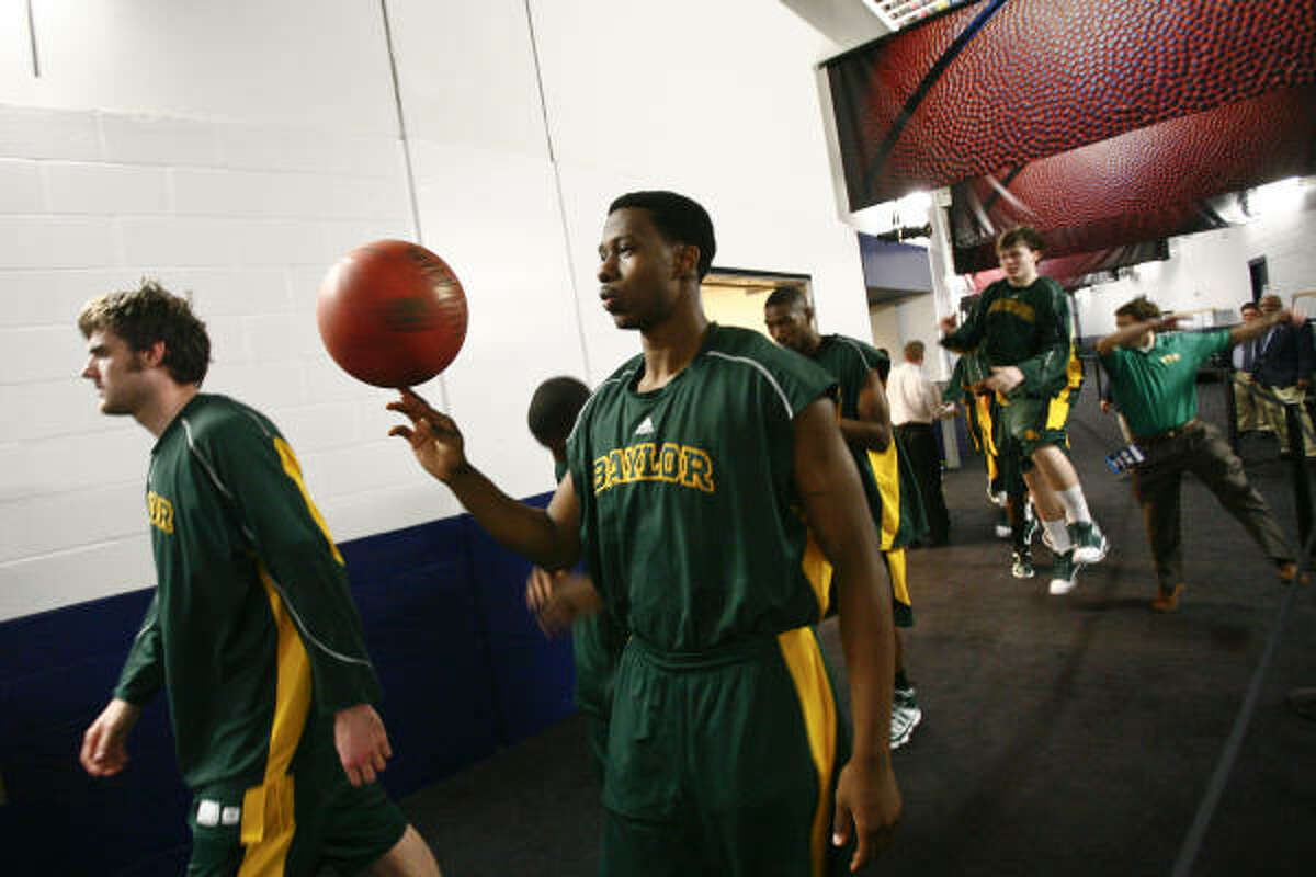The Baylor team exits their locker room and takes to the floor before the start of the 2010 NCAA Men's Basketball South Regional Championship men's college basketball game at Reliant Stadium.
