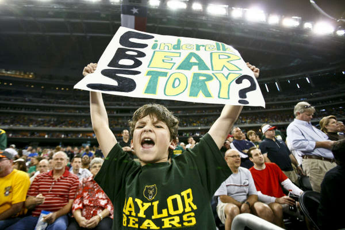 Clay Walters, 11, holds a sign before the start of the 2010 NCAA Men's Basketball South Regional Championship men's college basketball game.