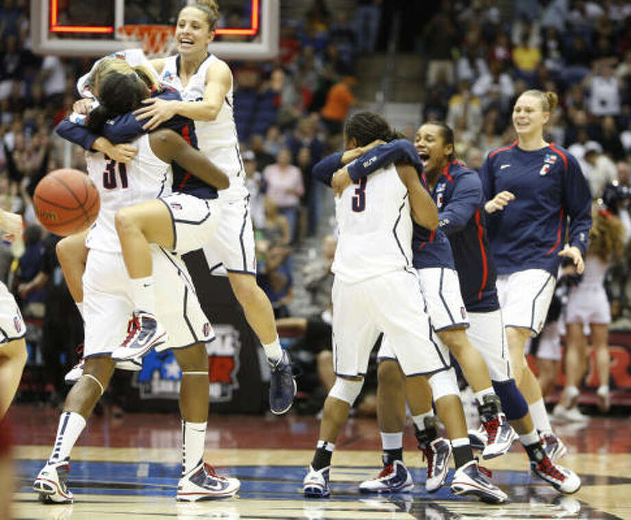 Connecticut celebrates its 53-47 victory over Stanford in the women's NCAA Final Four championship game. Photo: Nhat V. Meyer, MCT