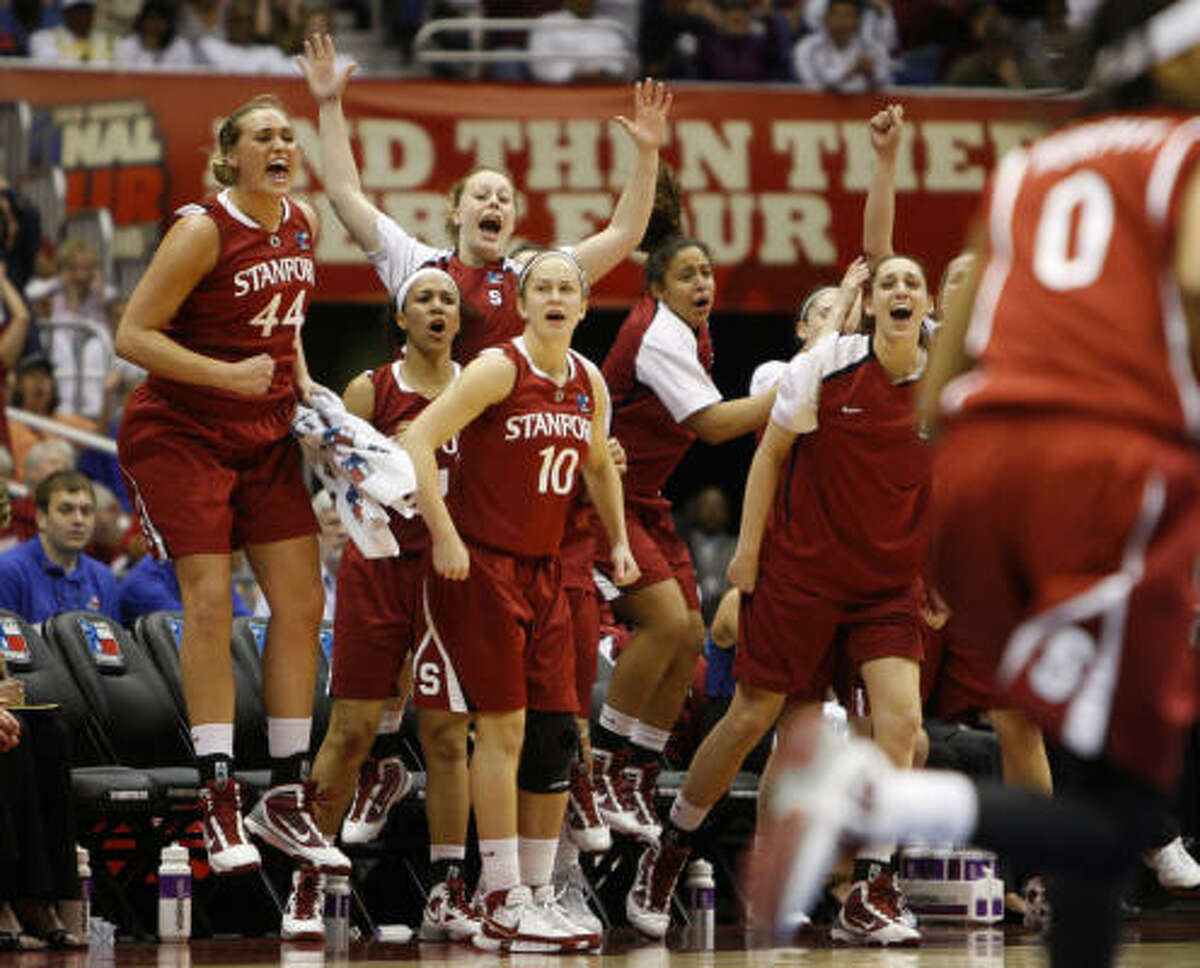 Stanford's bench cheers after a three-point shot by Kayla Pedersen against Connecticut in the first half. Stanford lead 20-12 at the half.