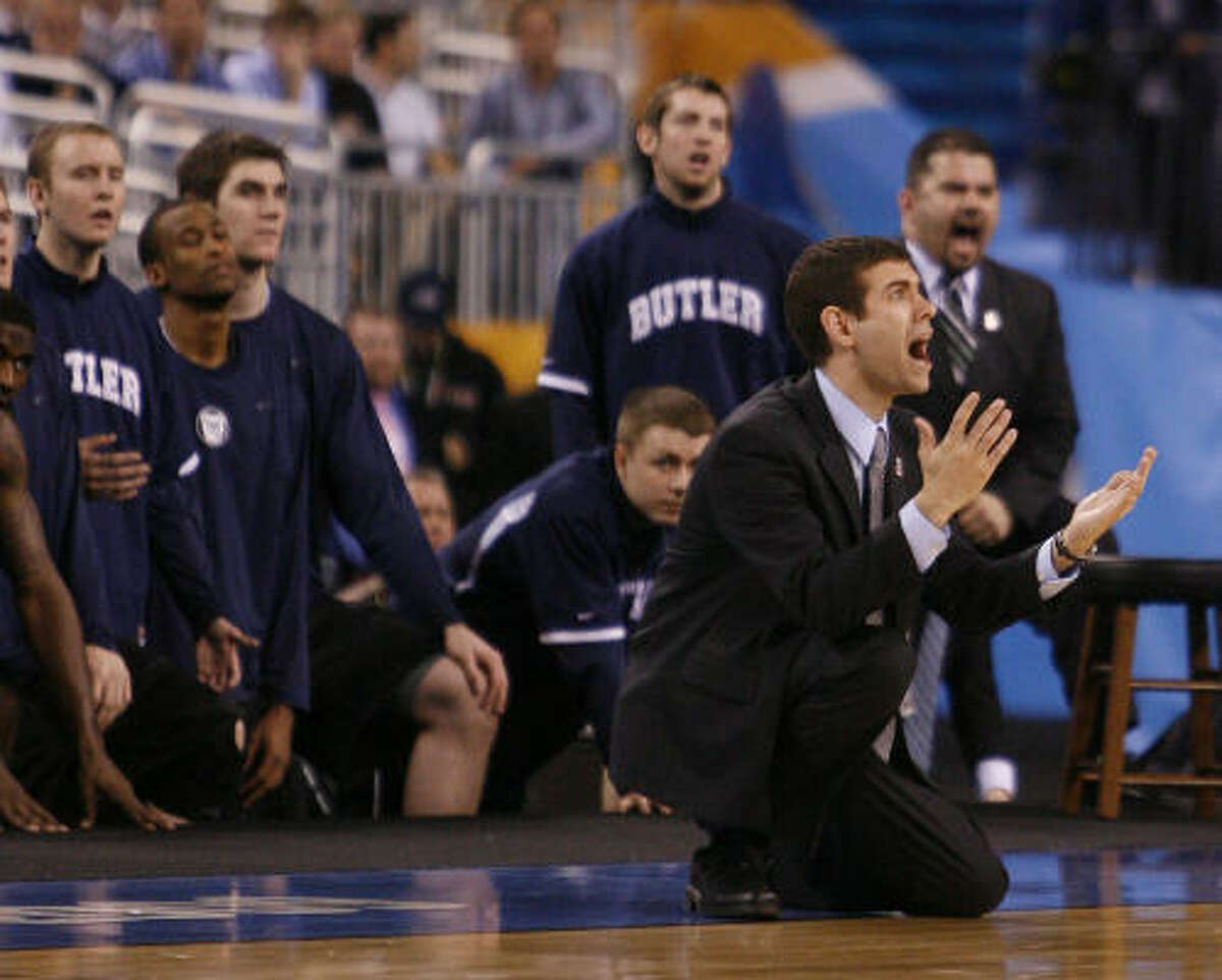 Butler head coach Brad Stevens falls to the floor after the refs did not call a foul on Duke during the second half of the 2010 NCAA Men's Final Four basketball championship.