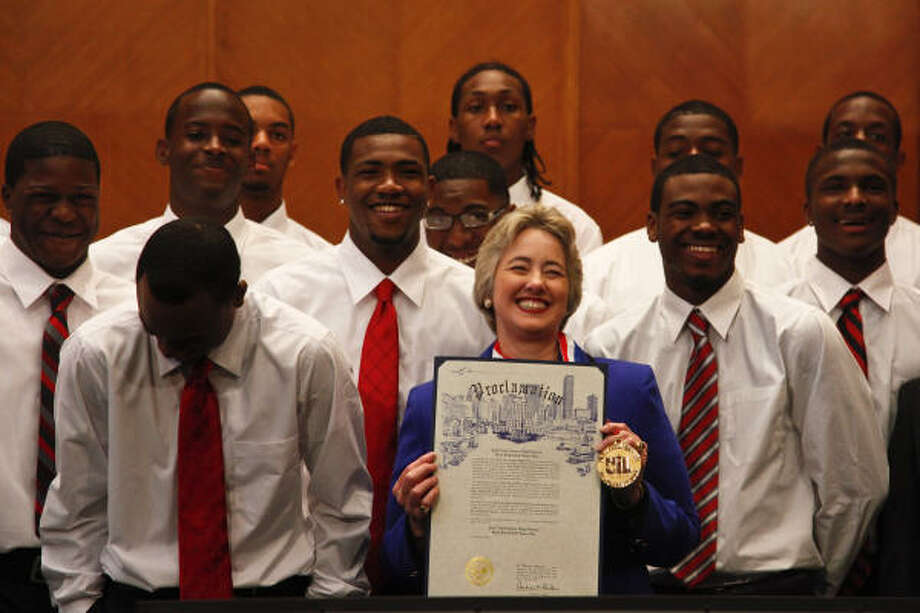 Houston City Mayor Annise Parker holds up a proclamation in honor of the Jack Yates High School basketball team at City Hall, in Houston. The Yates Lions went 34-0 this season and won their second consecutive Class 4A state championship. They are ranked No. 1 in the country in all five national high school polls. Photo: Michael Paulsen, Chronicle