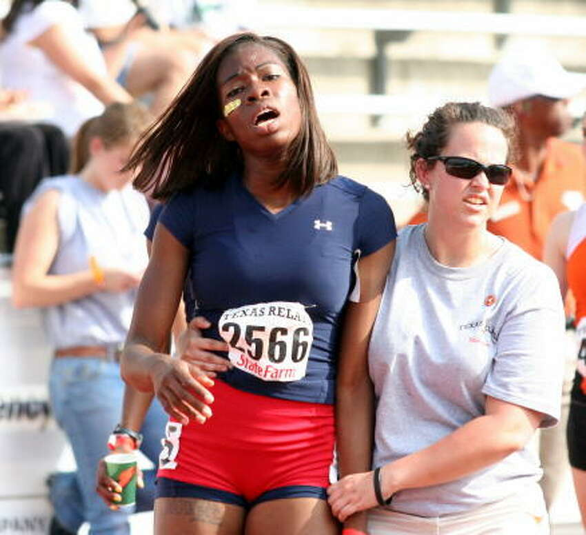 Lamar's Blessing Mayungbe catches her breath after running in the 400 meters at the Texas Relays in Austin.