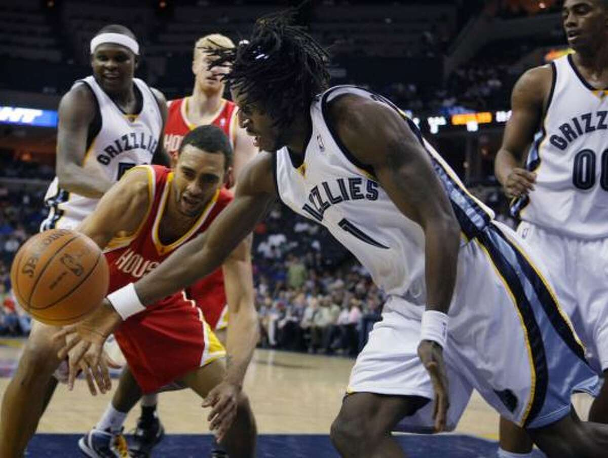 Rockets forward Jared Jeffries, left, and Grizzlies forward DeMarre Carroll scramble for a loose ball in the second half.