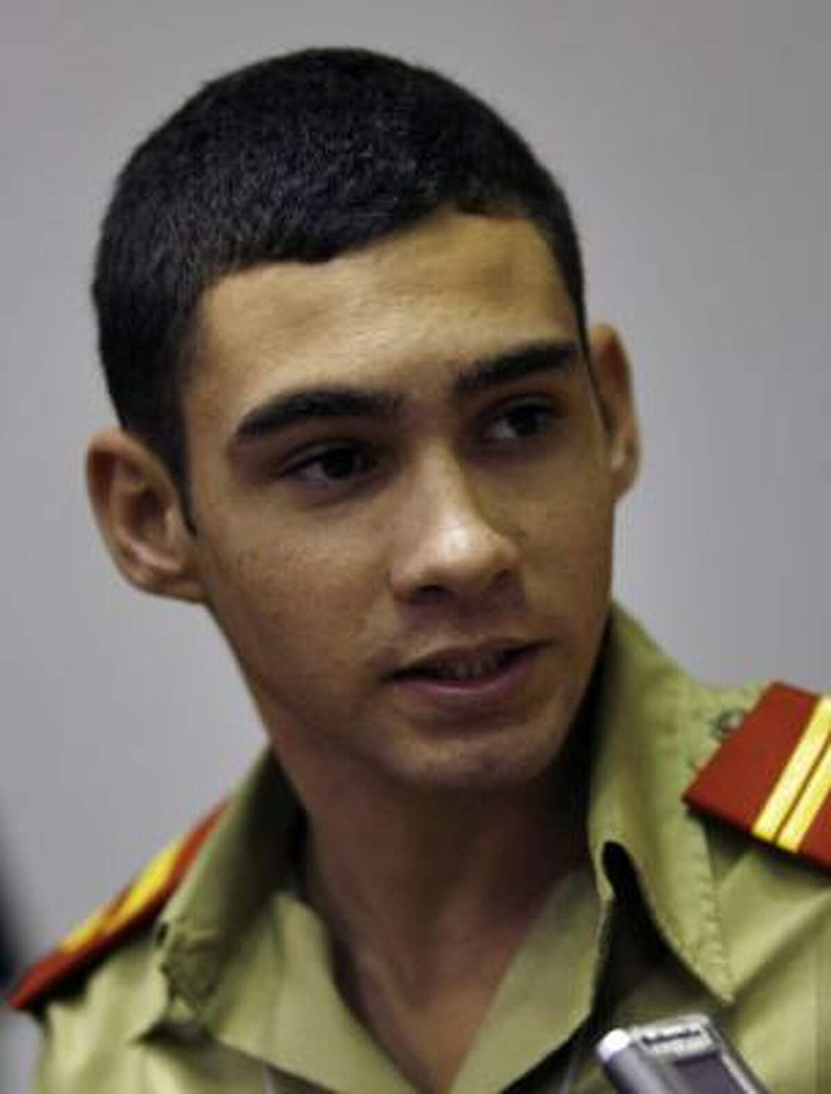 Elian Gonzalez attended the Cuba's Young Communist Union wearing an olive green military school uniform.