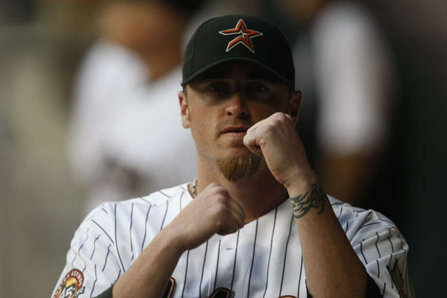 Astros pitcher Brett Myers pumps his fist as he mimics the pulling of a train's horn as the Astros train howls at the start of the game. Photo: Julio Cortez, Chronicle