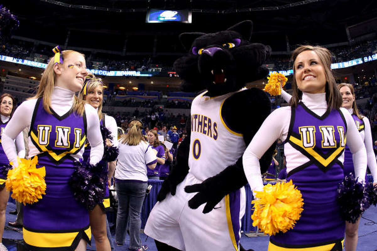 The mascot and cheerleaders from the Northern Iowa Panthers perform against the Kansas Jayhawks during the second round.