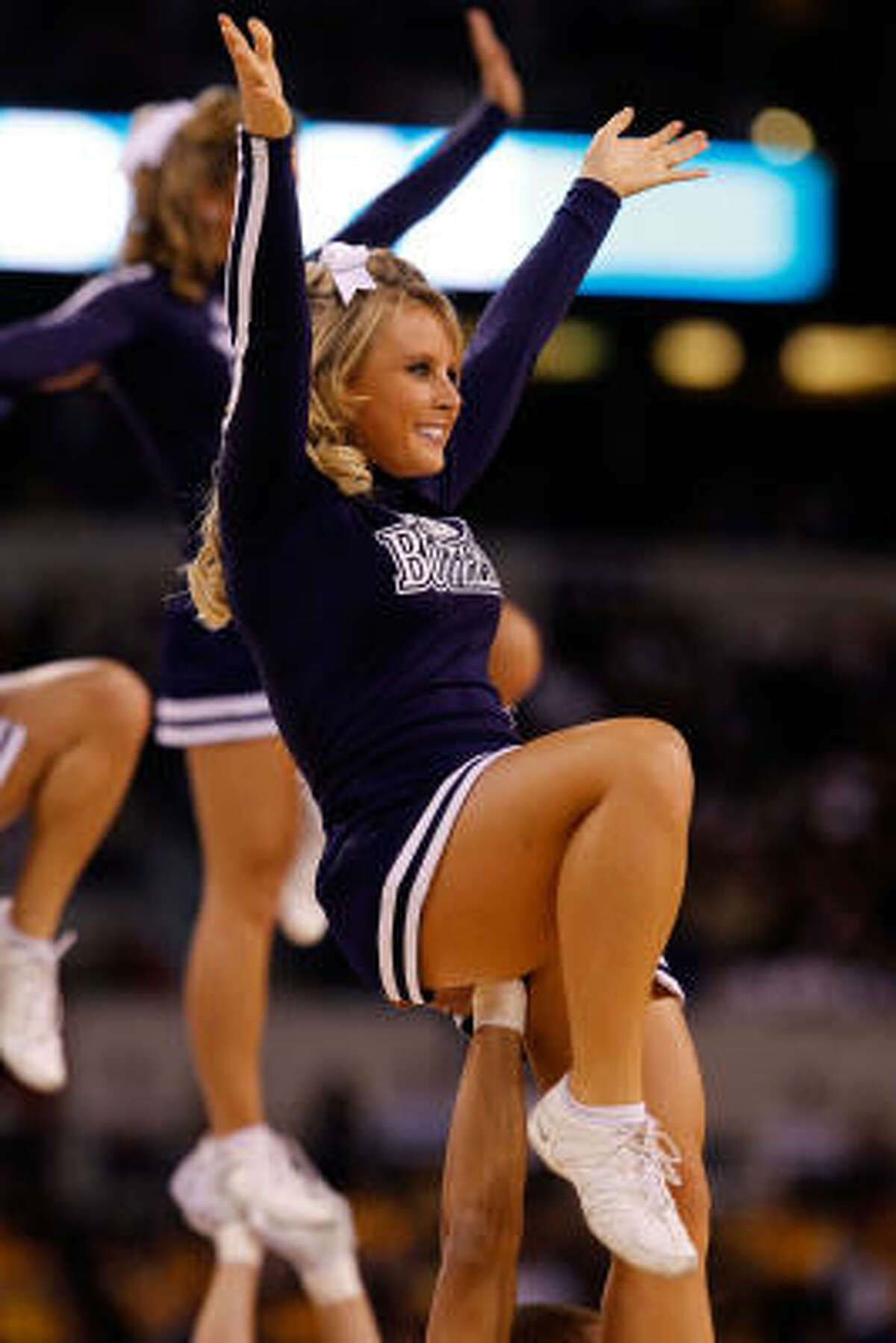 A cheerleader from the Butler Bulldogs performs against the Michigan State Spartans during the Final Four.