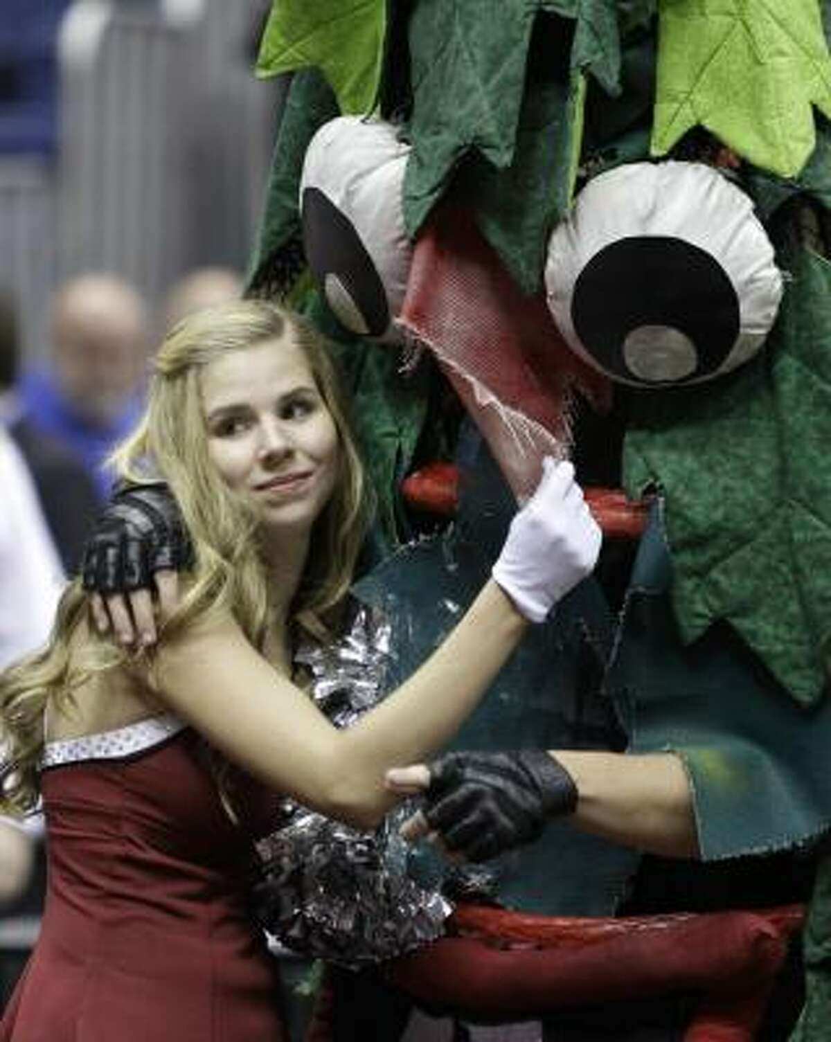 A member of the Stanford cheerleaders hugs the team mascot before the start of the women's NCAA Final Four championship game against Connecticut on Tuesday, April 6 in San Antonio.
