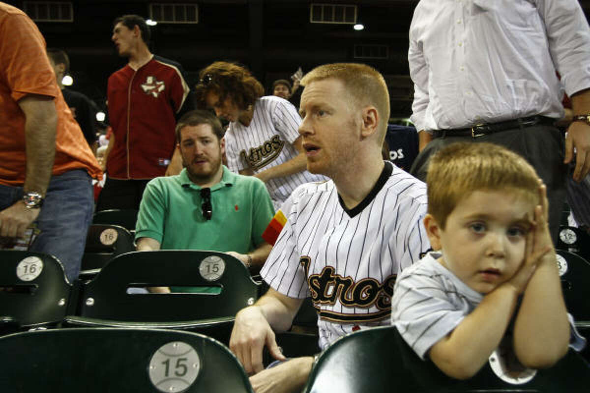 Dustin Bennette and Will Crews, 3, react at the end of the game.