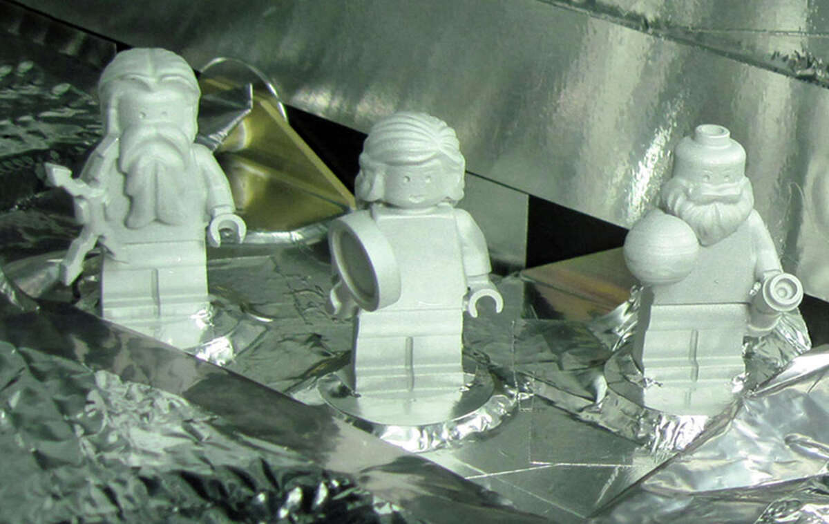 Juno, the San Antonio-led space mission to Jupiter, will also have onboard three Lego figures made from space-grade aluminum, NASA said Wednesday. Galileo, the Italian astronomer and mathematician who discovered Jupiter's moons is on the right, and accompanied by the Greek god Jupiter (left) and his wife Juno (center). Photo courtesy NASA