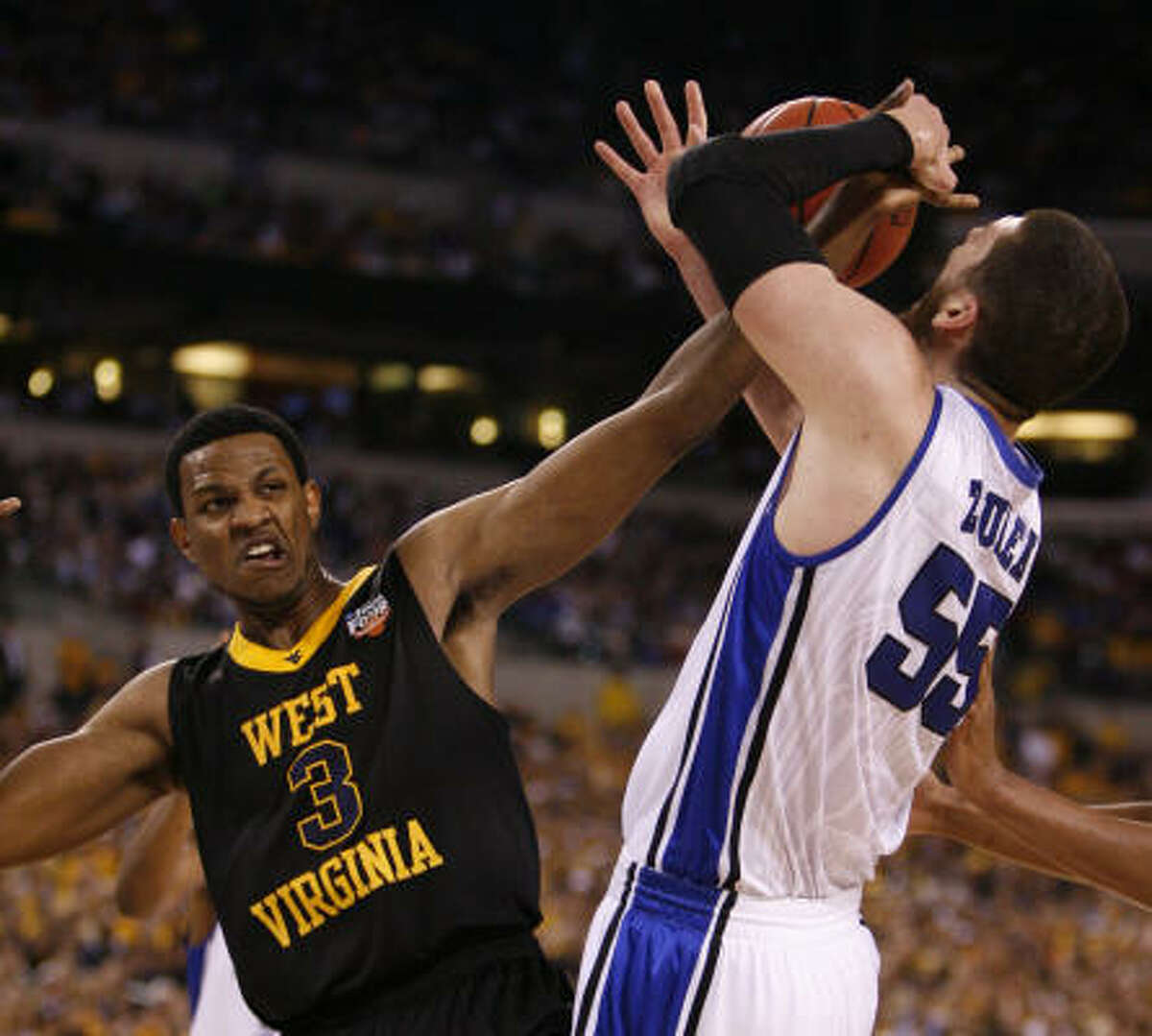 April 3: Duke 78, West Virginia 57 Duke center Brian Zoubek, right, and West Virginia forward Devin Ebanks battle for a loose ball in the first half.