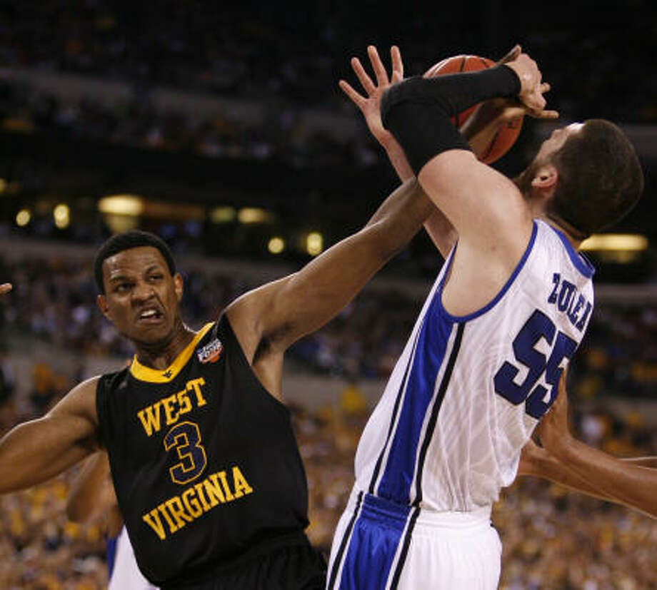 April 3: Duke 78, West Virginia 57Duke center Brian Zoubek, right, and West Virginia forward Devin Ebanks battle for a loose ball in the first half. Photo: Karen Warren, Chronicle