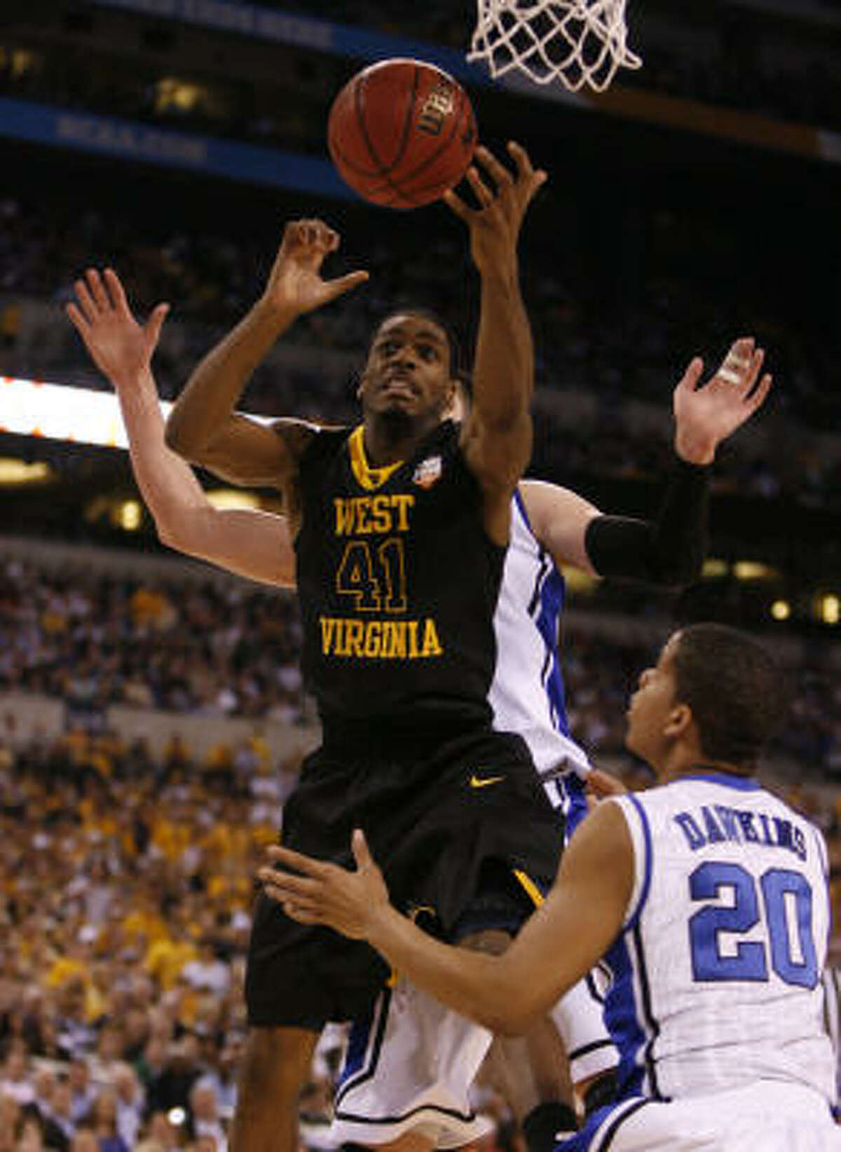 West Virginia forward John Flowers (41) tries to get to the basket during the first half.