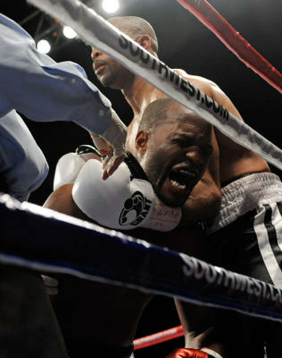 Bernard Hopkins reacts to an apparent low blow from Roy Jones Jr. during the 10th round.