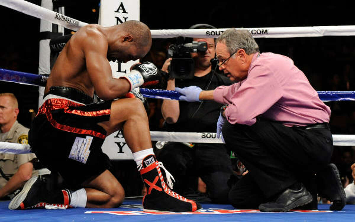 Bernard Hopkins is tended to by ringside doctor William Berliner after Hopkins was hit in the back of the head by Roy Jones Jr. during the eighth round.