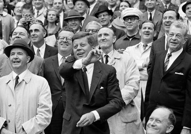 President John F. Kennedy throws out the first pitch in 1962. Photo: AP