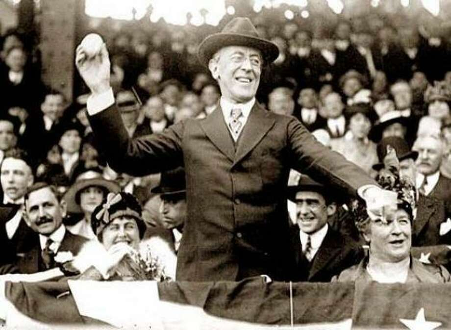President Woodrow Wilson threw out the ceremonial first pitch at a Washington Senators game in 1916. Photo: AP