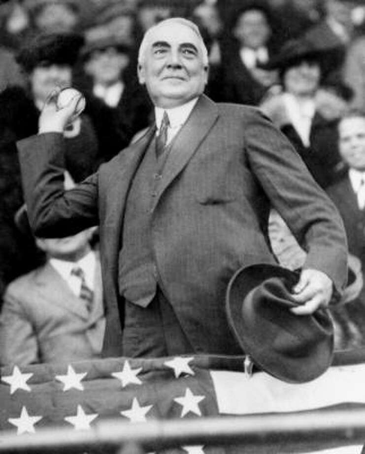 President Warren G. Harding throws out the first pitch to open the Washington Senators' baseball season in 1921. Photo: AP