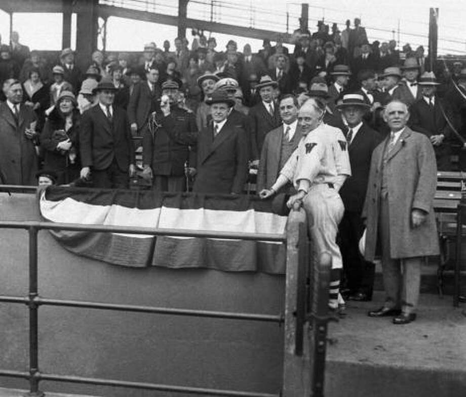 President Calvin Coolidge throws the first pitch before a game in 1928. Photo: AP