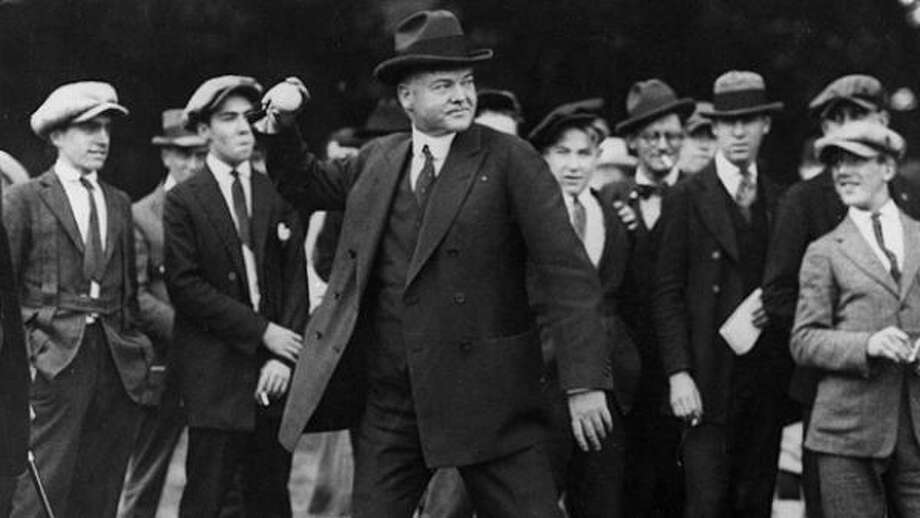 President Herbert Hoover throws out the ceremonial first pitch in this undated photo in the early 1930s. Photo: Getty Images