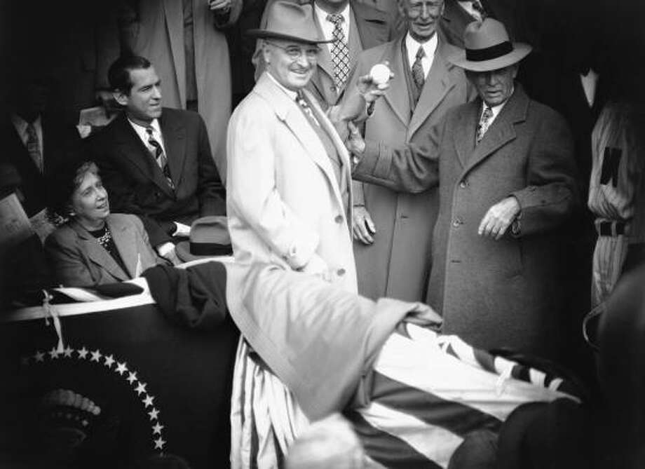 In 1950, President Harry Truman threw out two ceremonial pitches — one from each hand. Photo: William J. Smith, AP