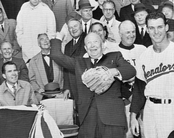 President Dwight Eisenhower throws out the ceremonial first pitch to open the 1960 season. Photo: AP