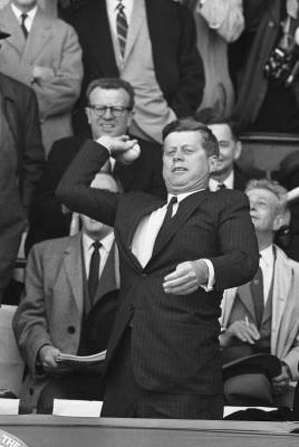 President John F. Kennedy makes the throw to open the baseball season at Griffith Stadium in 1961. Photo: AP