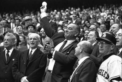 President Lyndon B. Johnson throws out the first pitch at the Washington Senators' game to open the 1964 season. Photo: AP
