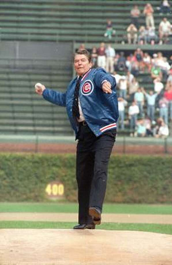President Ronald Reagan throws out the ceremonial first pitch at Wrigley Field in 1988. Photo: Charles Tasnadi, AP