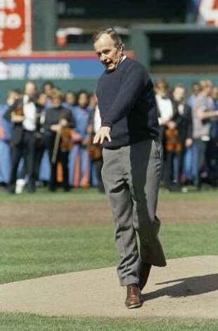 President George H.W. Bush reacts after throwing a one-hopper during the ceremonial first pitch to open Oriole Park at Camden Yards in Baltimore in 1992. Photo: J. Scott Applewhite, AP