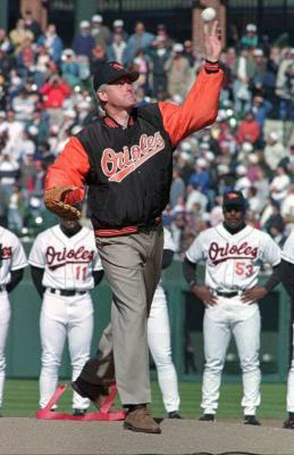 President Bill Clinton throws out the ceremonial first pitch at the Orioles' season opener against the Kansas City Royals in 1996. Photo: David Hammond, AP