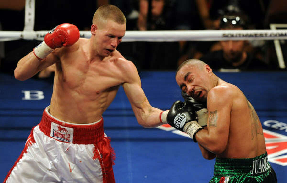 Jason Litzau, left, lands a punch on Rocky Juarez during their NABF super featherweight title fight bout at the Mandalay Bay Resort in Las Vegas.