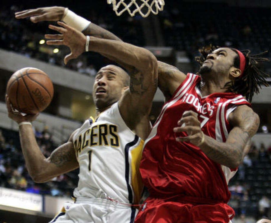 Pacers' Dahntey Jones, left, is fouled by Houston Rockets' Jordan Hill. Photo: Tom Strattman, AP
